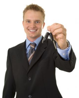 happy salesman with keys